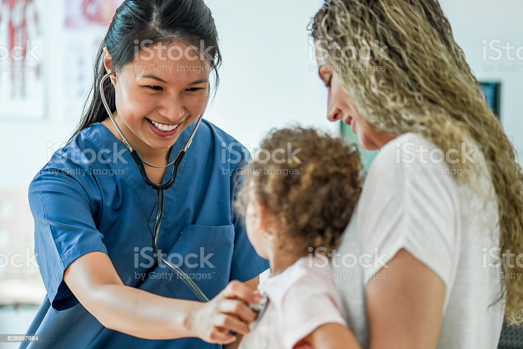 Little Girl at a Check Up stock photo