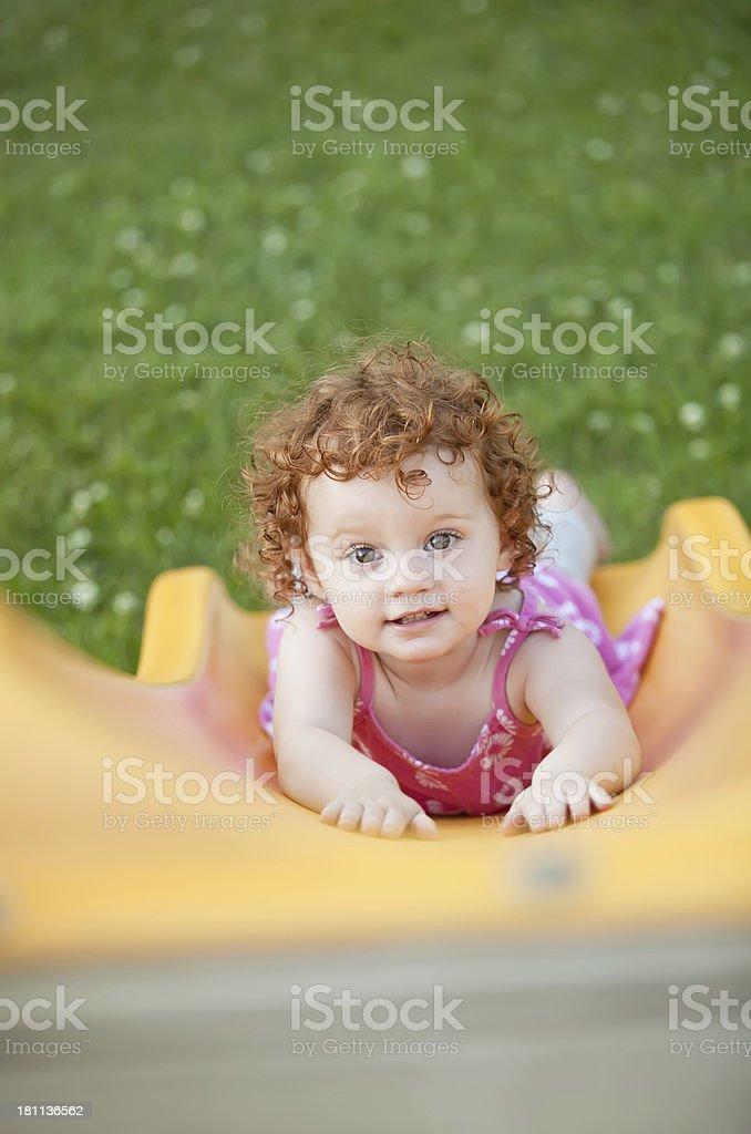 Little Girl at Bottom Of Slide royalty-free stock photo