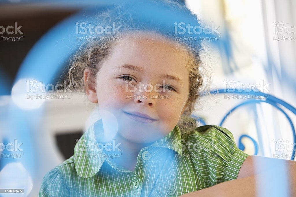 Little girl at cafe table stock photo