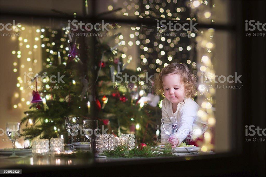 Little girl at Christmas dinner stock photo