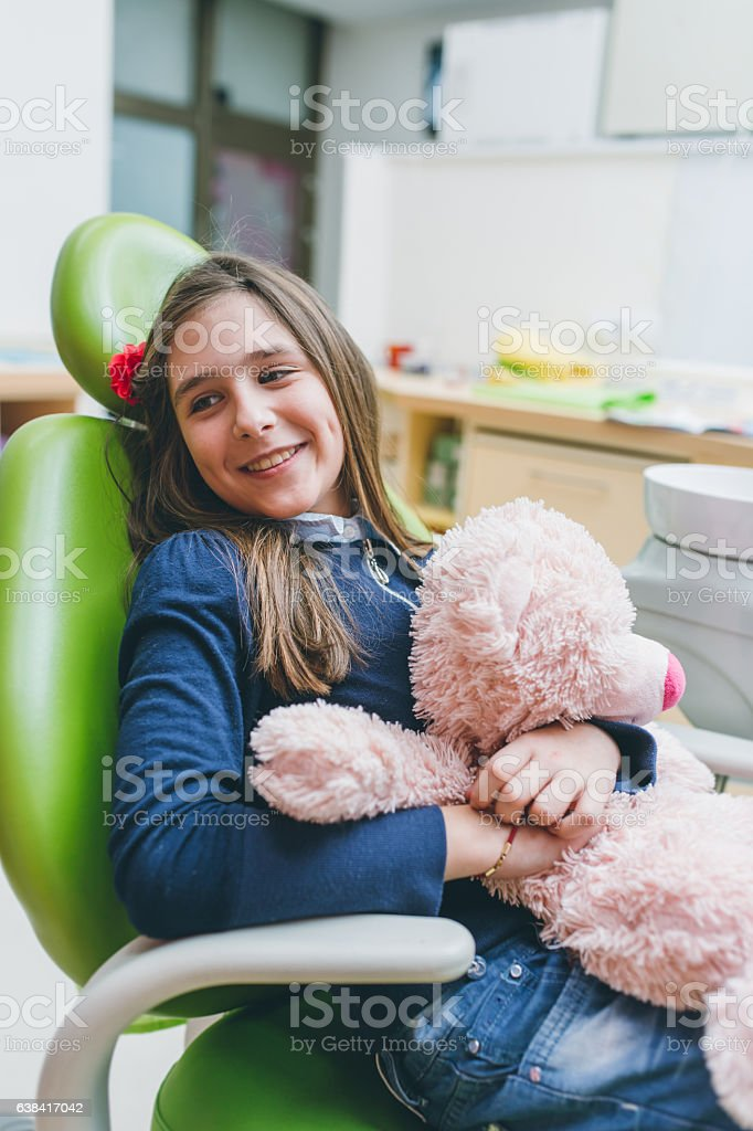 Little girl at dentist stock photo