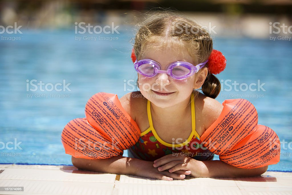 Little girl at edge of pool stock photo