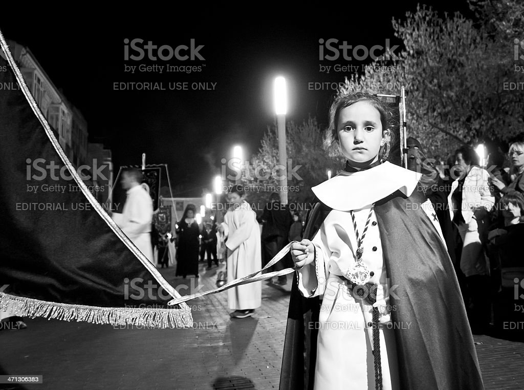 Little girl at Holy Week procession stock photo