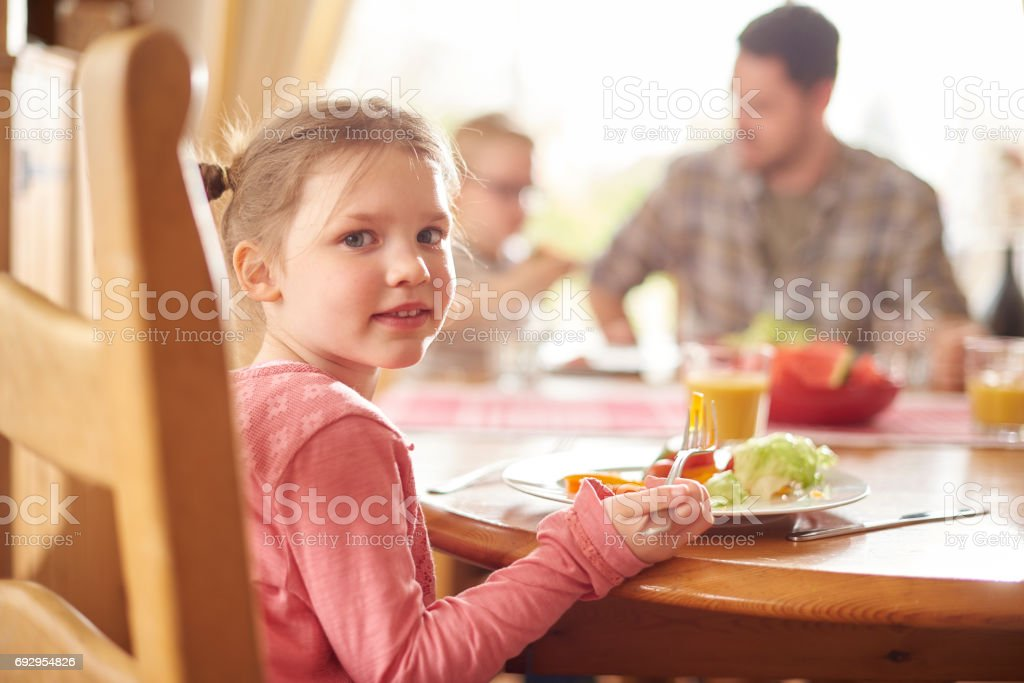 little girl at lunch stock photo