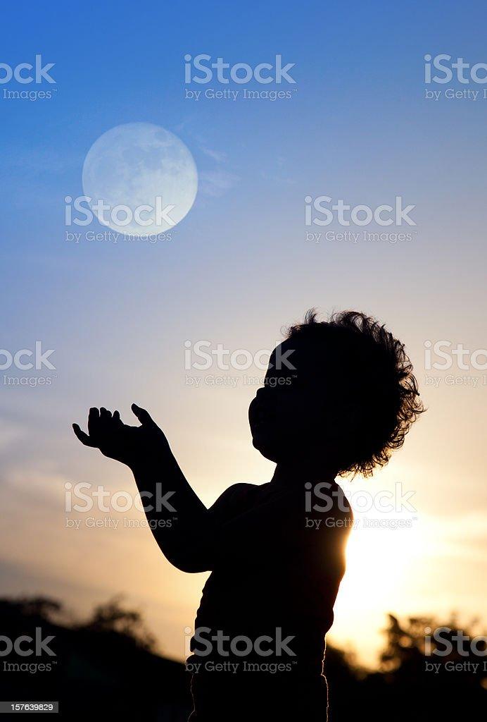 Little girl at sunset stock photo