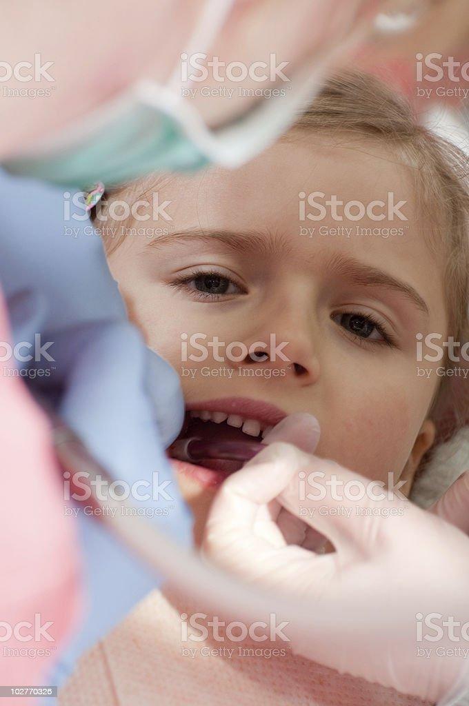 Little girl at the dentist stock photo