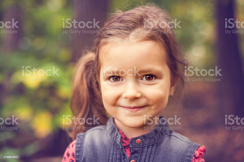 Little girl at the park close up portrait stock photo