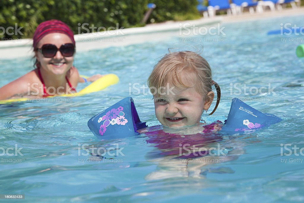 Little girl at the pool stock photo