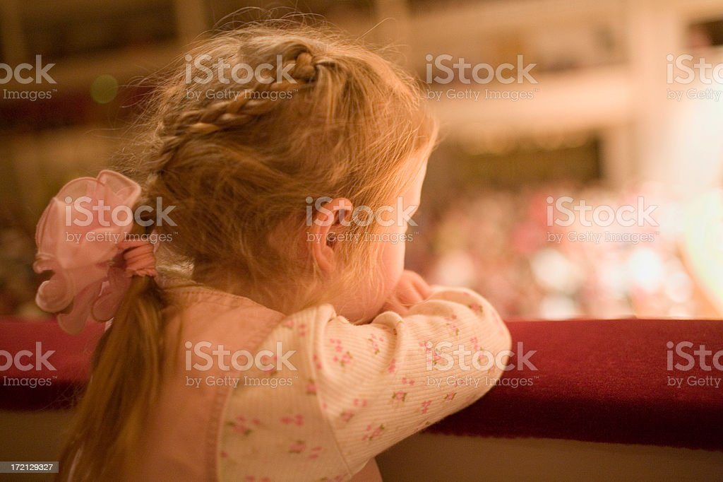 Little girl at the theater royalty-free stock photo