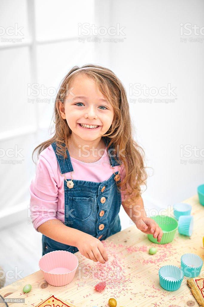 Little girl baking cookies stock photo