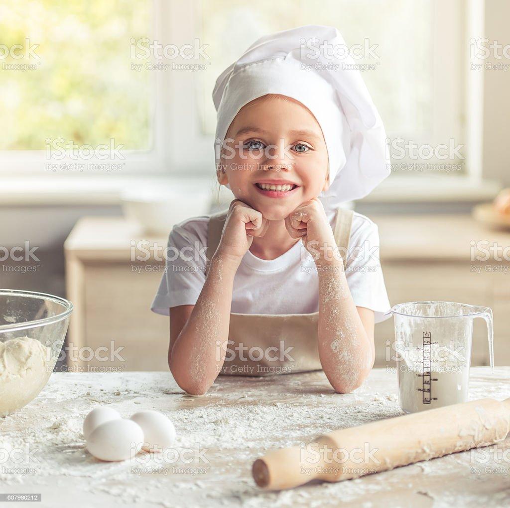 Little girl baking stock photo