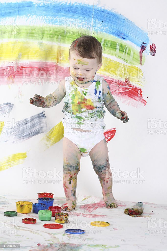 little girl bedaubed with bright colors royalty-free stock photo
