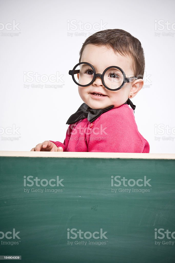 Little girl  behind a chalkboard. royalty-free stock photo