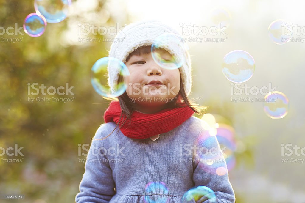 little girl blowing bubble royalty-free stock photo