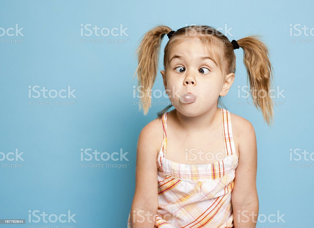Little Girl Blowing Bubbles with her Bubble Gum royalty-free stock photo