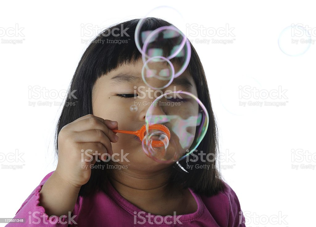 Little Girl Blowing Soap Bubbles royalty-free stock photo
