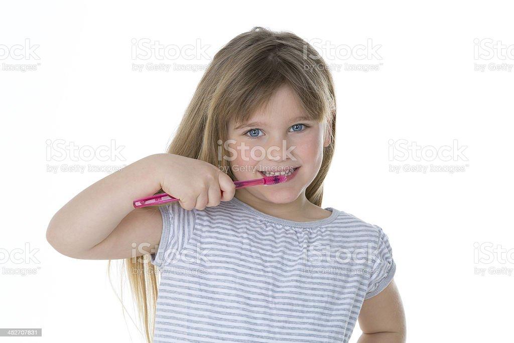 little girl brushing her teeth stock photo