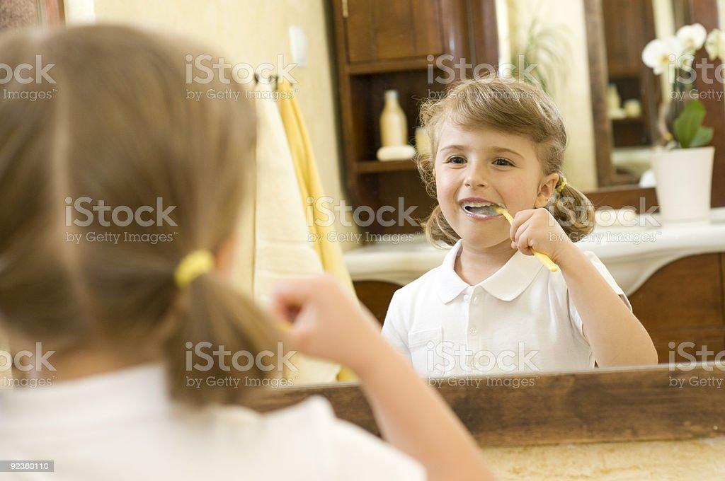 Little girl brushing teeth royalty-free stock photo