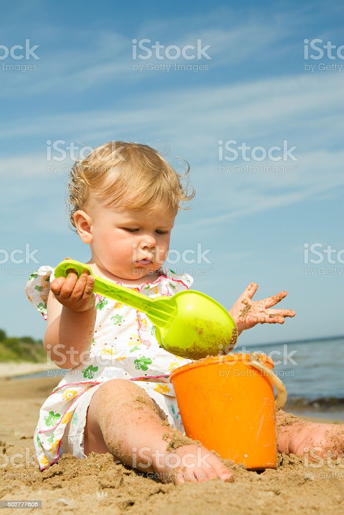 little girl by the sea. stock photo