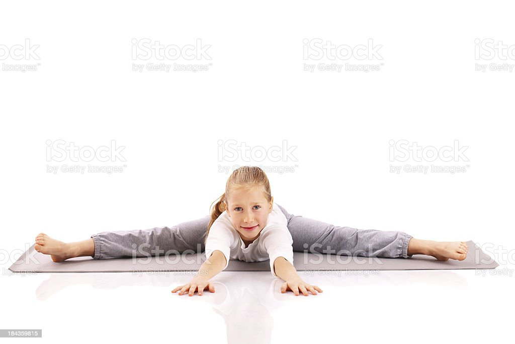 Little girl carries out gymnastic exercises. royalty-free stock photo