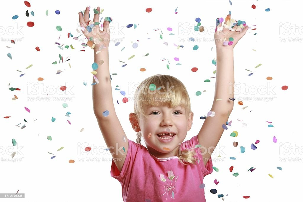 Little girl celebrating with falling confetti on white background royalty-free stock photo
