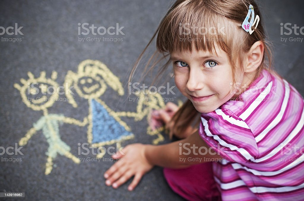 Little girl chalking royalty-free stock photo