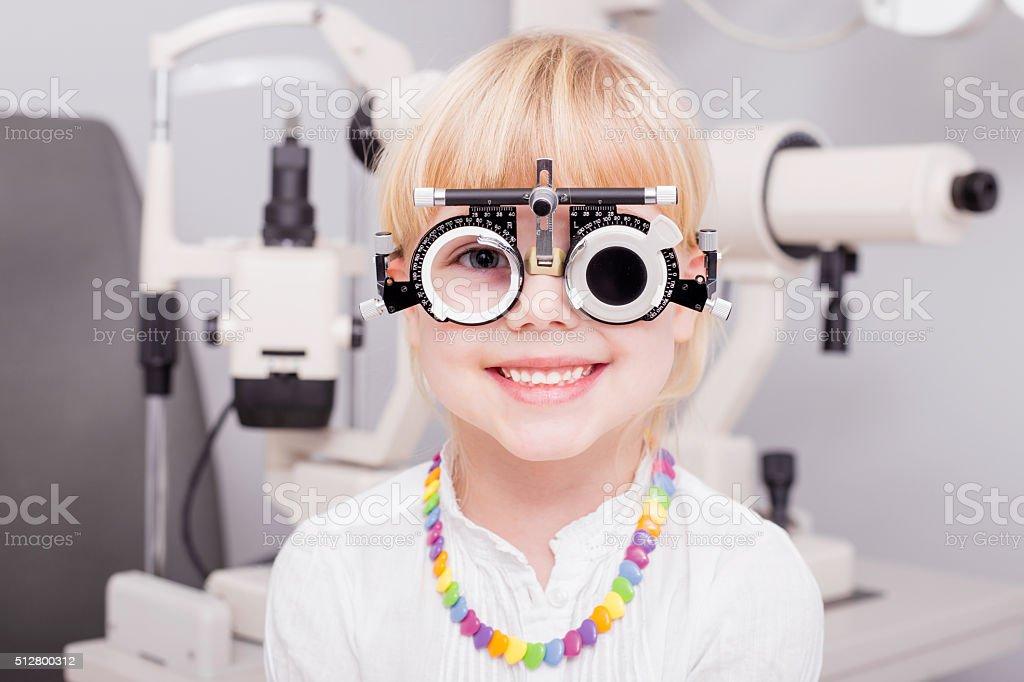 Little girl checking her vision stock photo