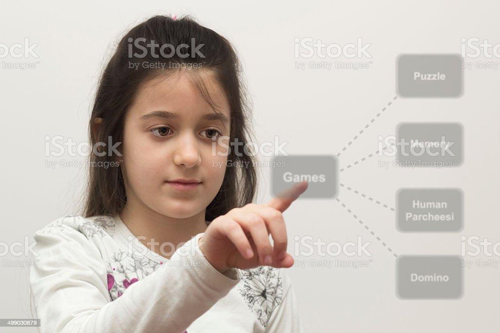 little girl chooses game stock photo