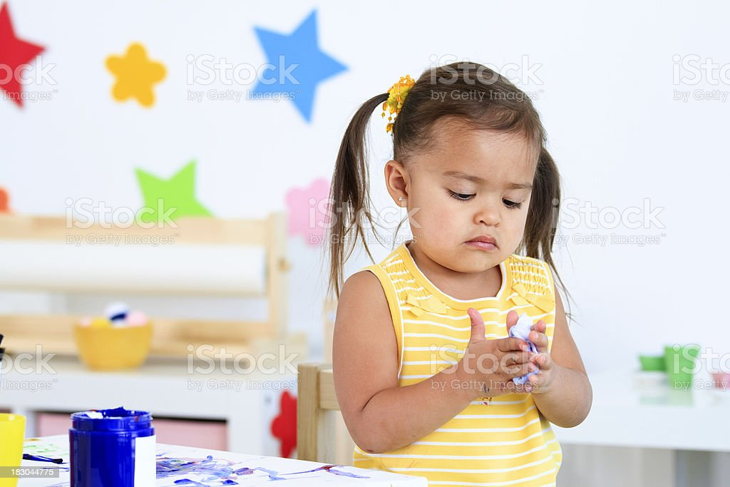 Little Girl Cleaning Her Hands royalty-free stock photo