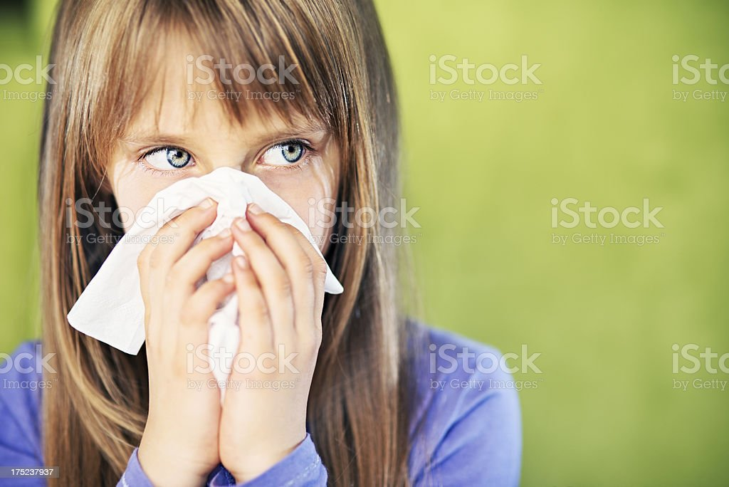 Little girl cleaning nose royalty-free stock photo