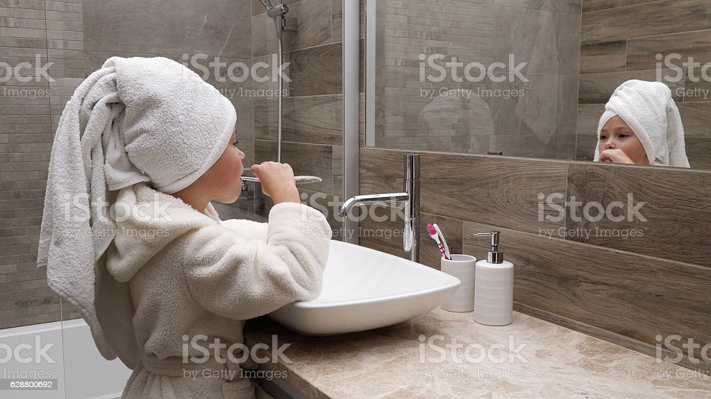 little girl cleaning teeth stock photo