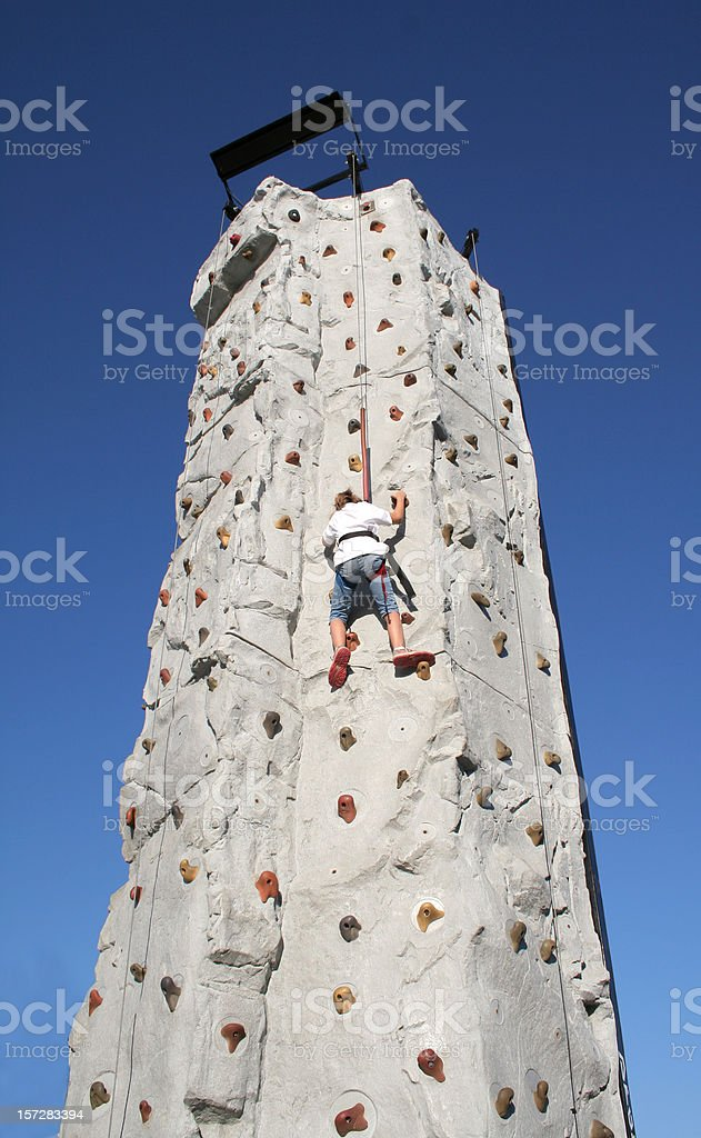 Little Girl Climbing A Tall Wall royalty-free stock photo