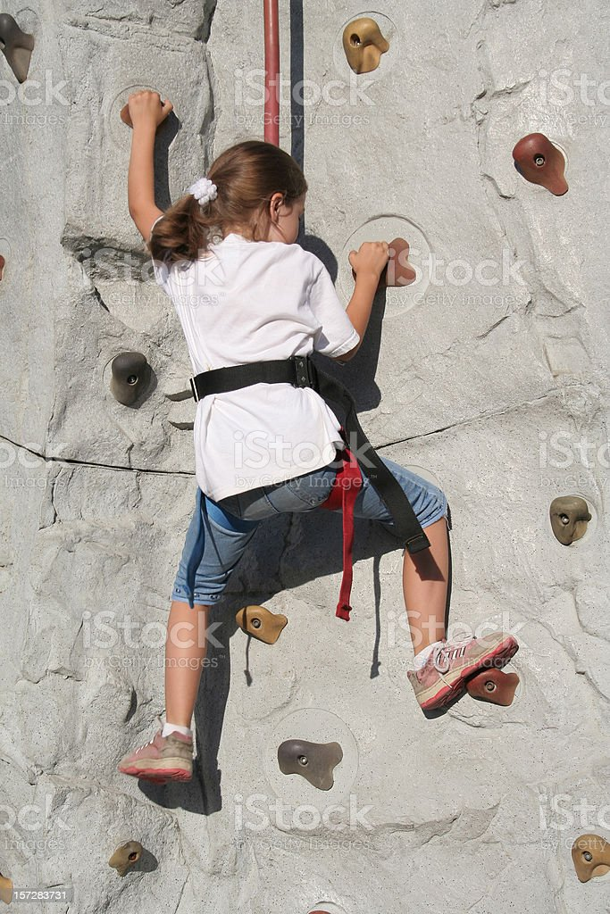 Little Girl Climbing A Wall royalty-free stock photo