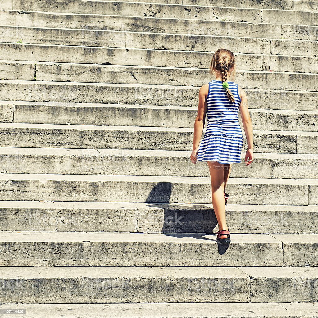 Little girl climbing stairs royalty-free stock photo
