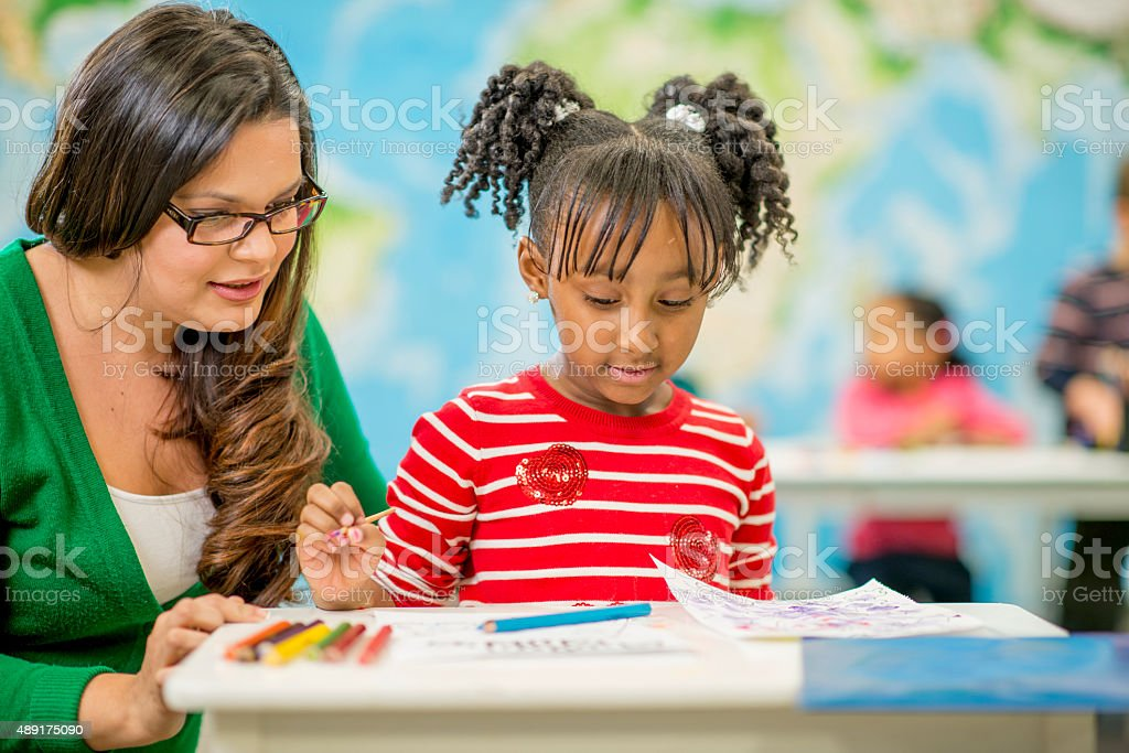 Little Girl Coloring at School stock photo
