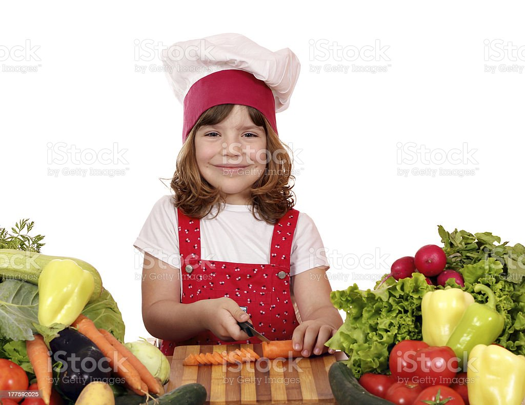 little girl cook cutting carrot royalty-free stock photo