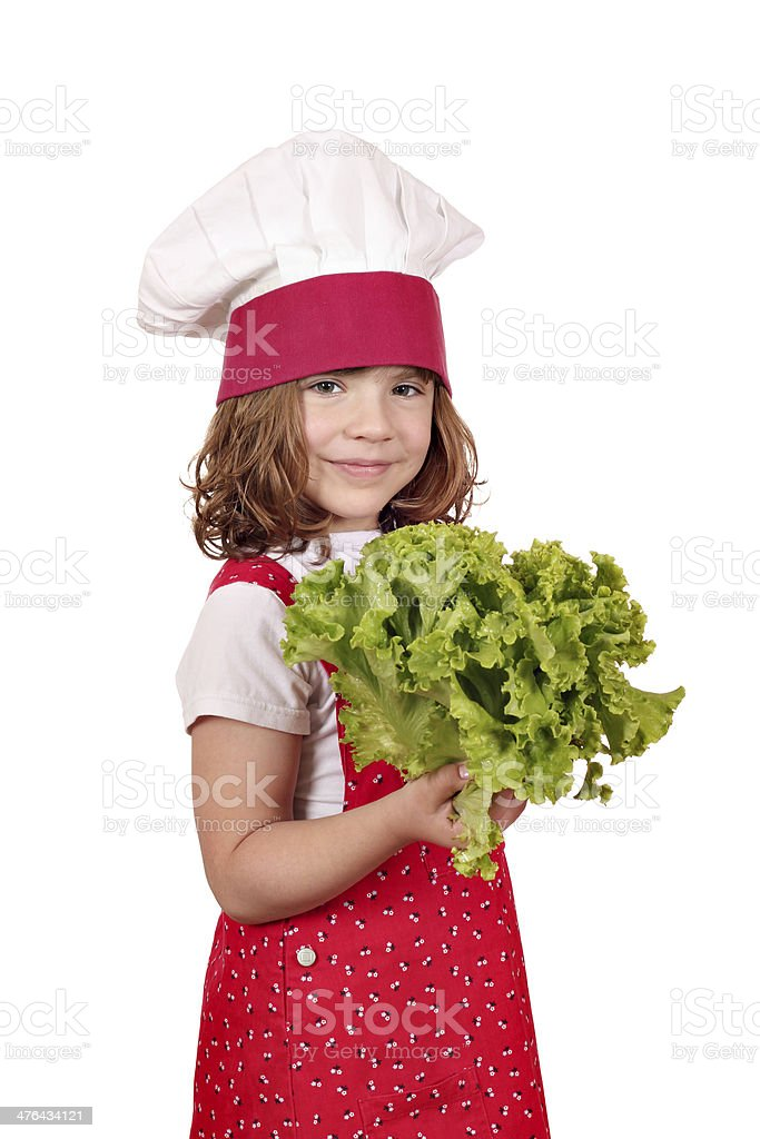 little girl cook holding green salad royalty-free stock photo