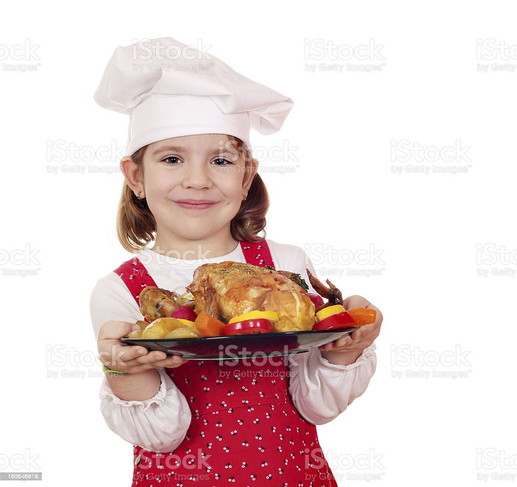 little girl cook holding roasted chicken royalty-free stock photo
