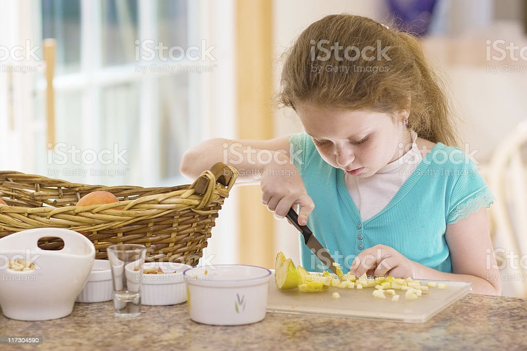 Little girl cook the fruit salad stock photo