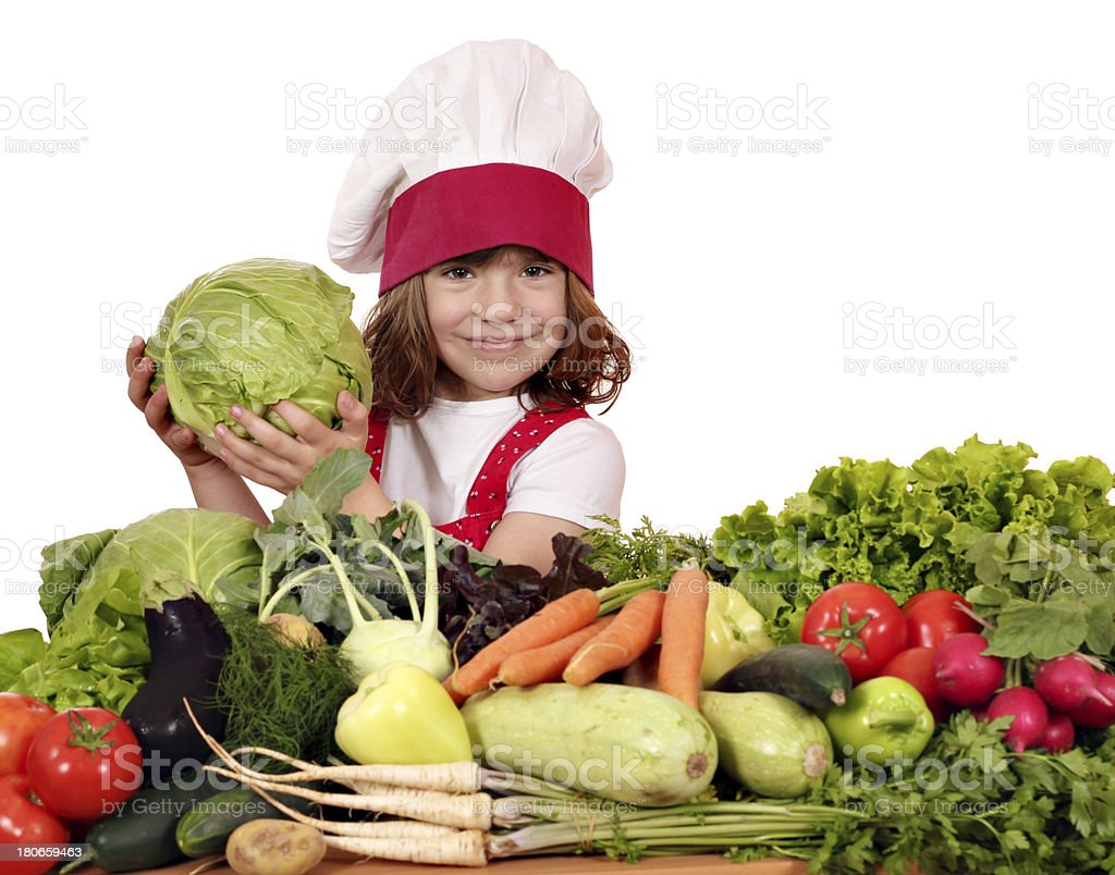 little girl cook with cabbage and vegetables royalty-free stock photo