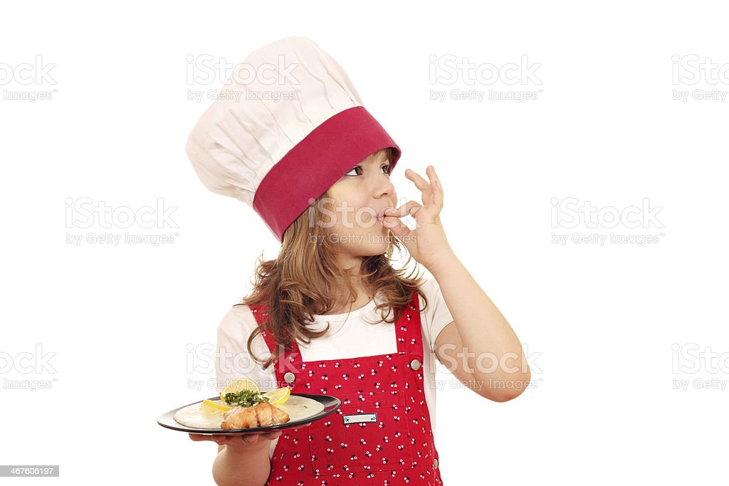 little girl cook with salmon and ok hand sign stock photo