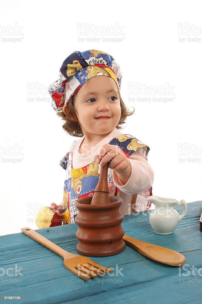 Little girl cooking dressed as a chef royalty-free stock photo