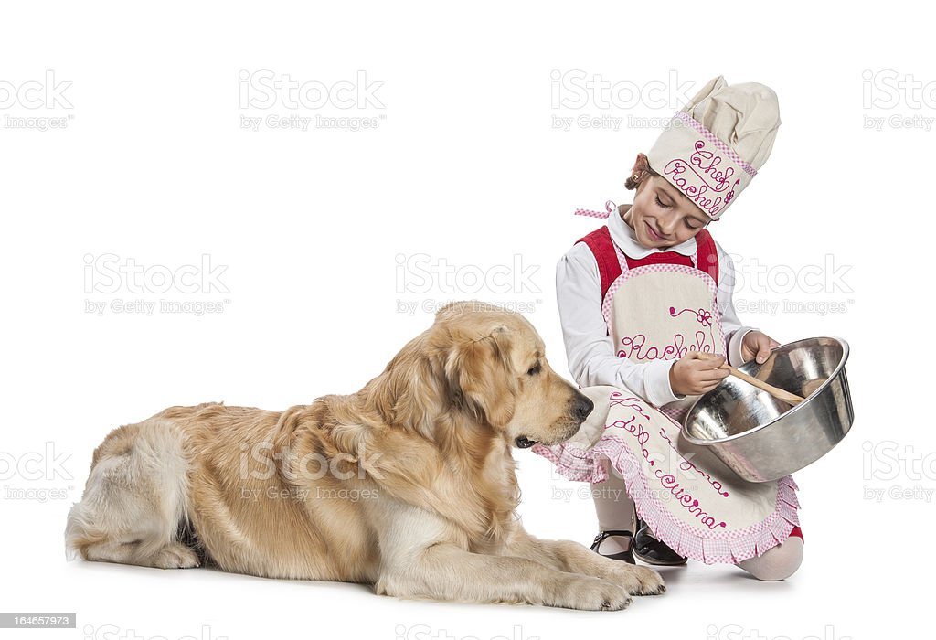 little girl cooking for her dog royalty-free stock photo