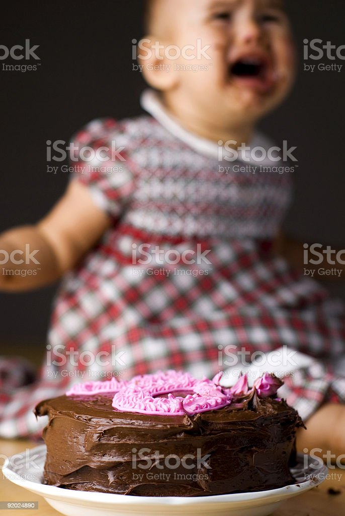 little girl crying at her birthday party royalty-free stock photo