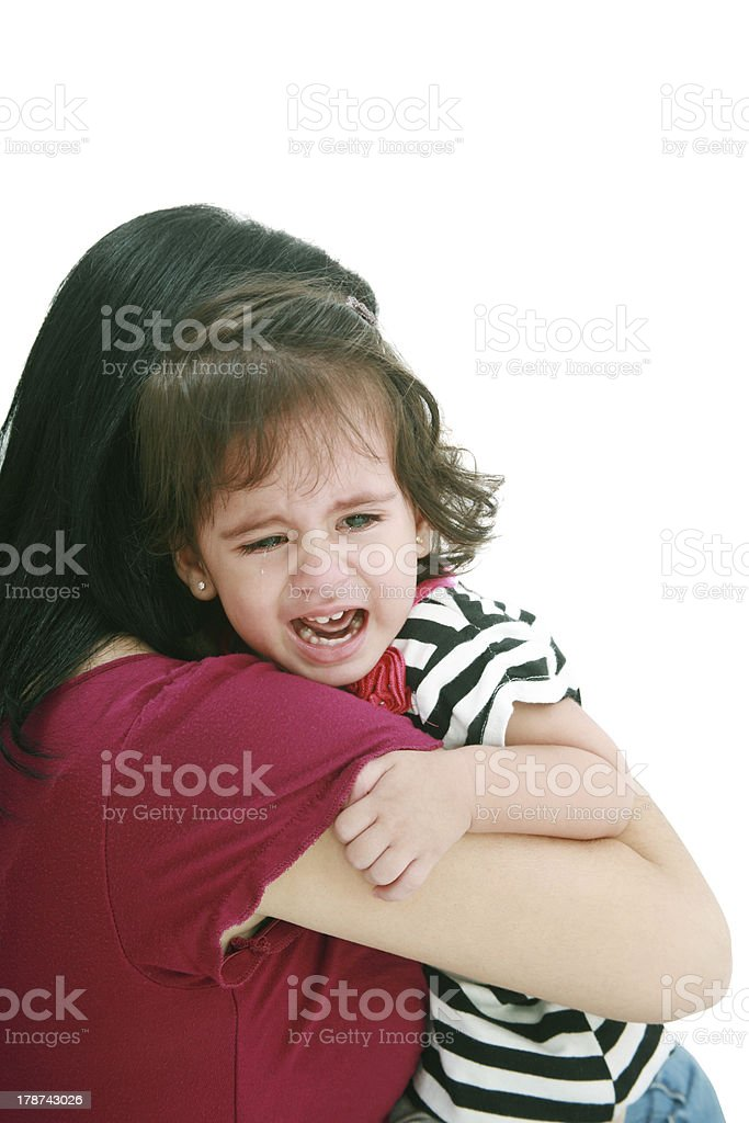 Little girl crying in mothers arm royalty-free stock photo