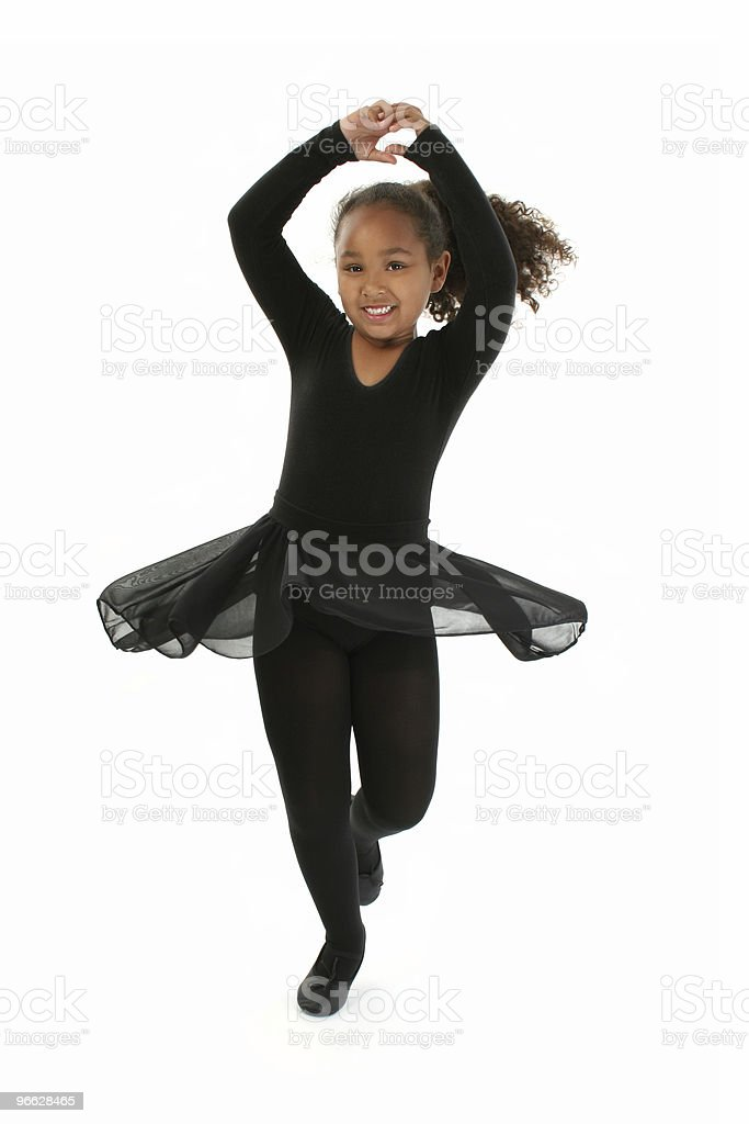 Little girl dancing ballet and wearing black outfit royalty-free stock photo