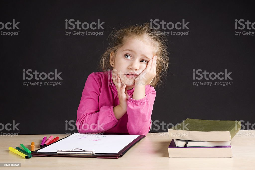 Little girl day dreaming in class royalty-free stock photo