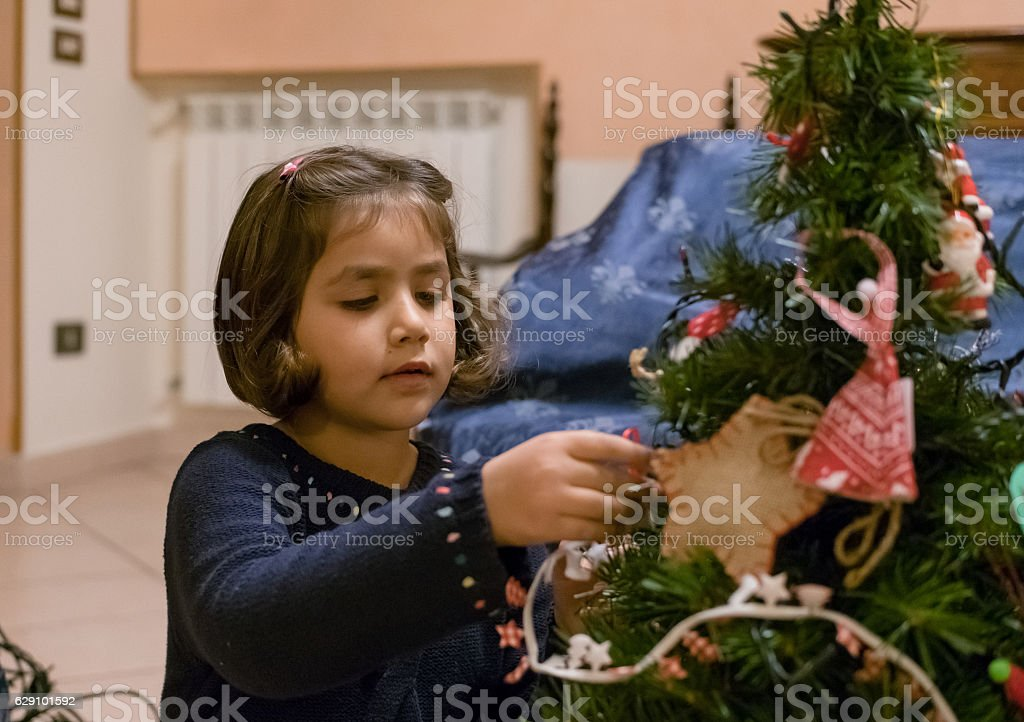Little Girl Decorating Christmas Tree stock photo