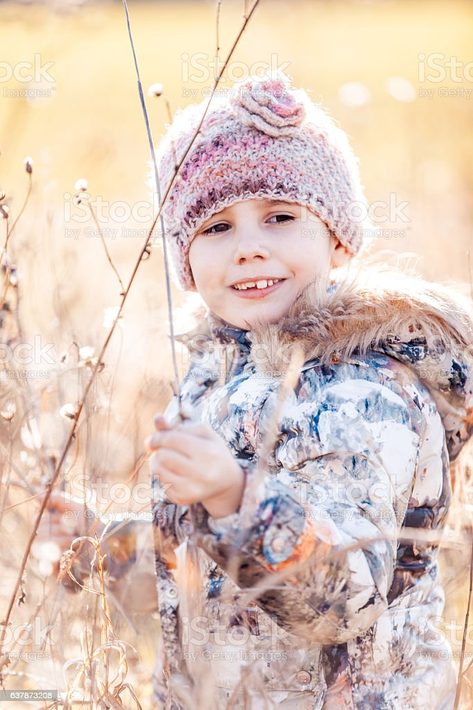 Little Girl Discovering and Enjoying Nature stock photo