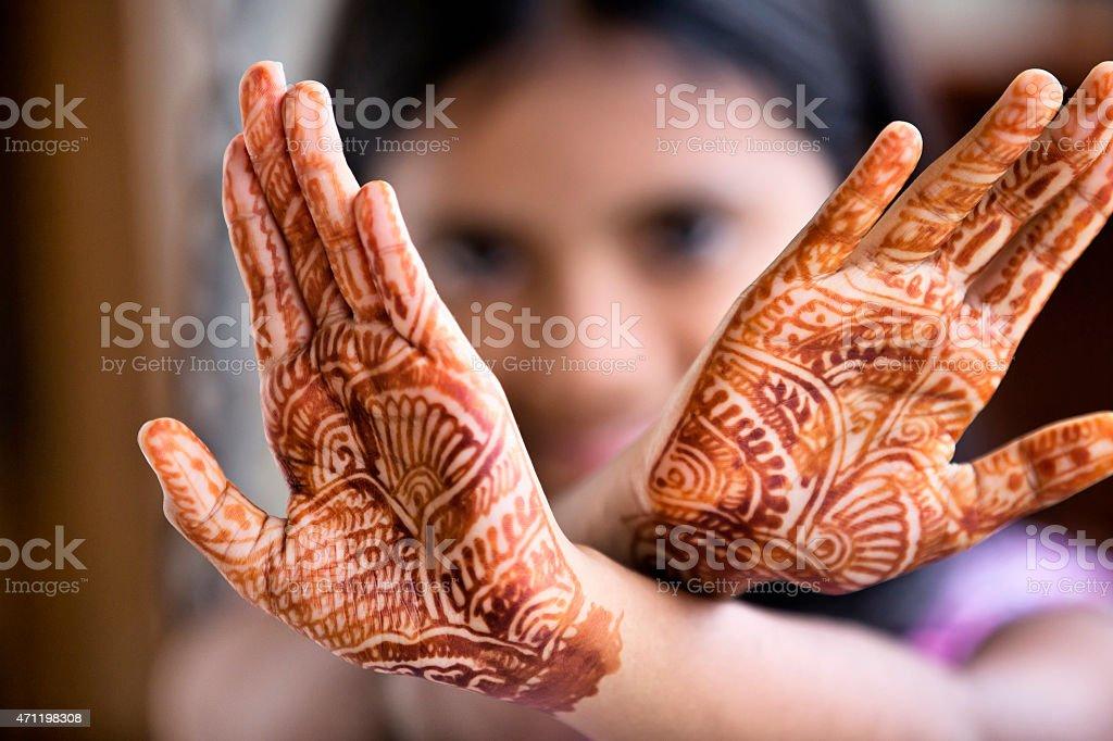Little Girl displaying henna tattoo also called Mehendi stock photo